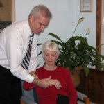 Chiropractor Weymouth MA Eric Diener inspecting wrist