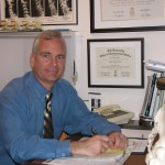 Chiropractor Weymouth MA Eric Diener at his desk