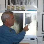 Chiropractor Weymouth MA Eric Diener studying xrays