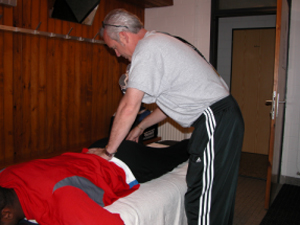 Chiropractor Weymouth MA Eric Diener adjusting track athlete